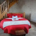 lit rond de la chambre d'hôte la Tour Levoy